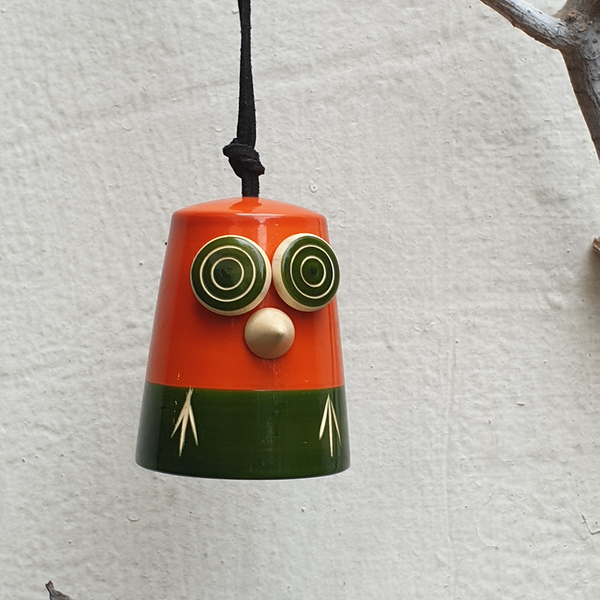 orange-green wooden owl bell