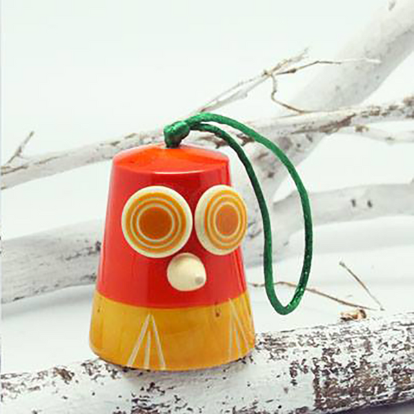 yellow-orange wooden owl bell