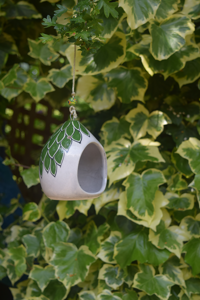 pictured in garden- green and white hand painted tealight holder, including a green bead on string