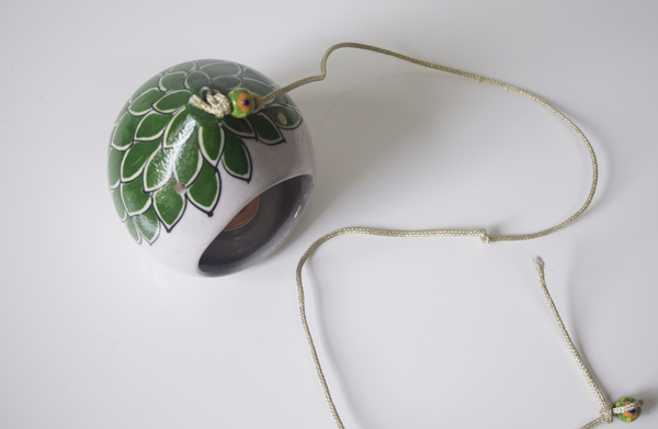 top view- green and white hand painted tealight holder, including green beads on string