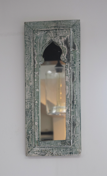 Rustic green and white distressed mirror on wall