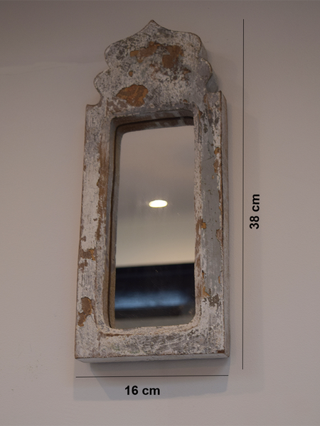 grey-white dome shaped distressed mirror against with measurements