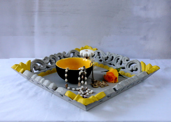 grey tray with yellow flowers and accessories