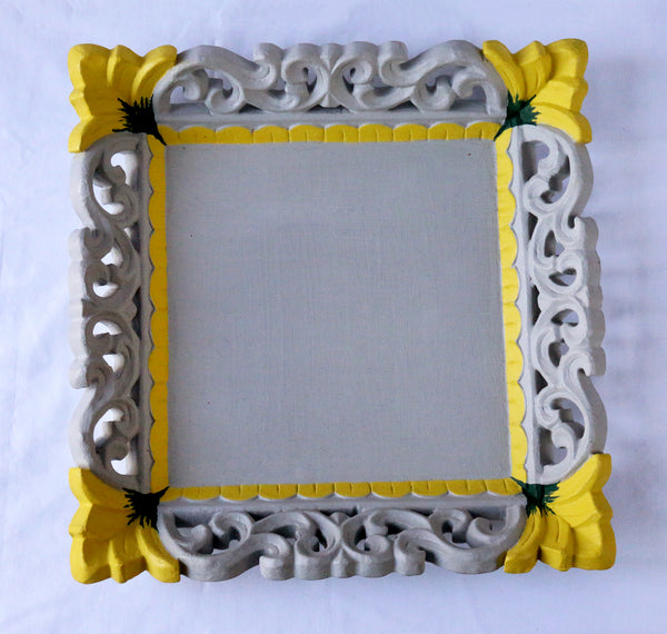 Grey tray with painted yellow flowers top view