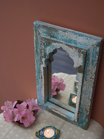 distressed blue minaret mirror against terracotta background