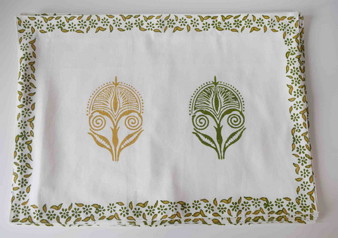 white tablemat with green and mustard floral block print.
