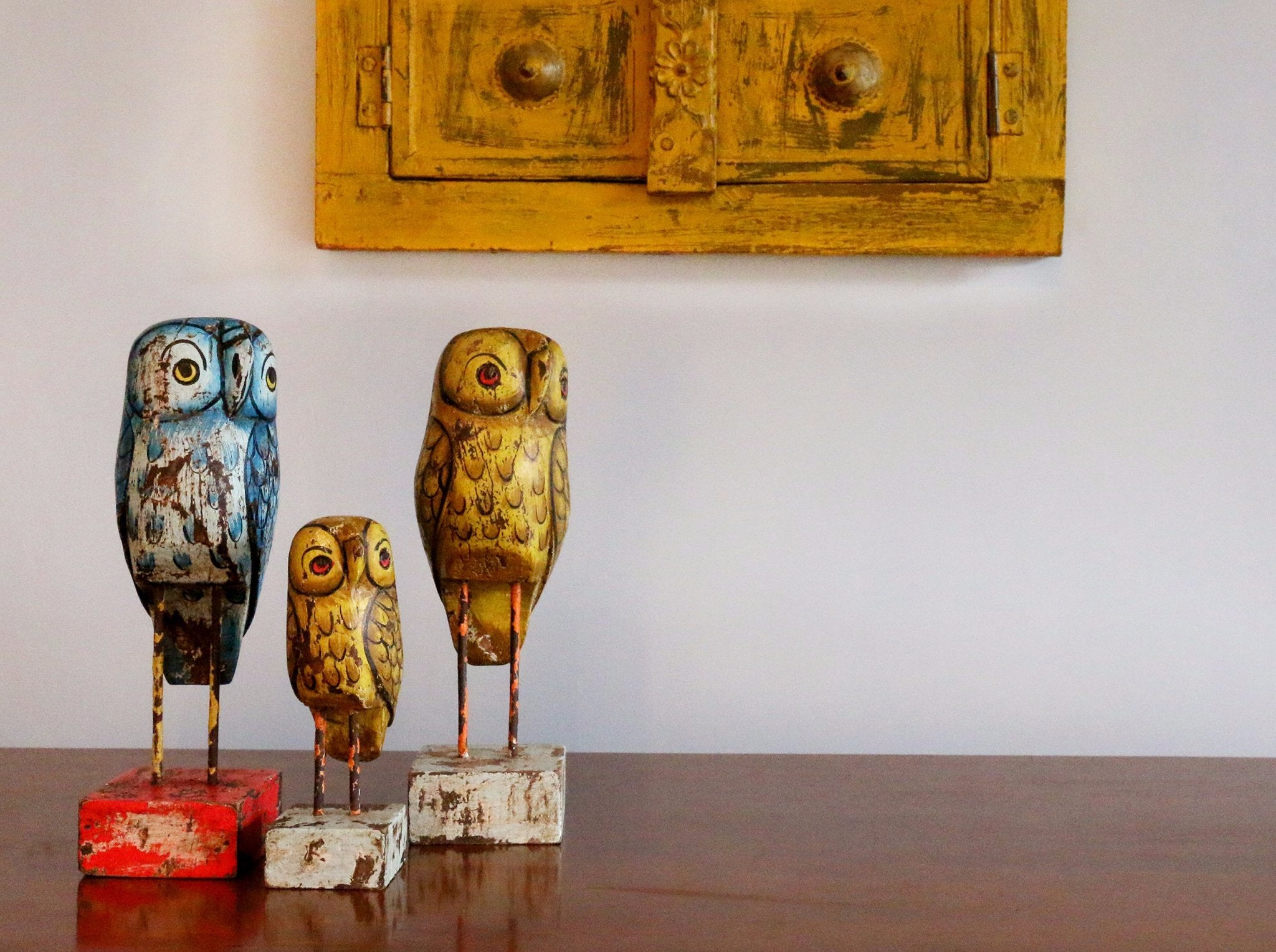 reclaimed wood set of 3 owls, blue, yellow and yellow with a yellow window in the background