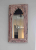 distressed pink, red and white dome shaped reclaimed wood mirror