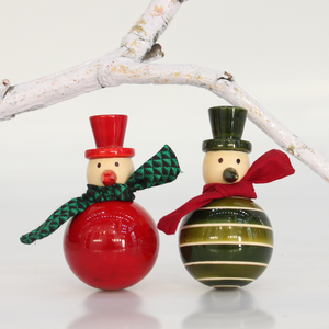 red and green wooden dancing snowmen