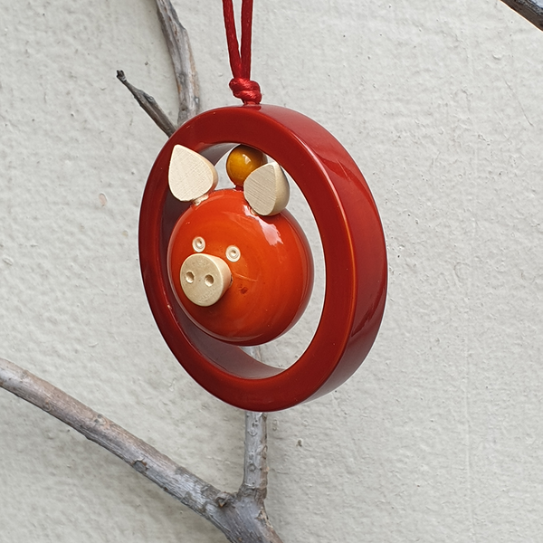 Orange Oink-in-a-ring Christmas ornament