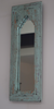 Rustic sea green distressed mirror on wall