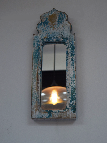 distressed blue dome shaped mirror