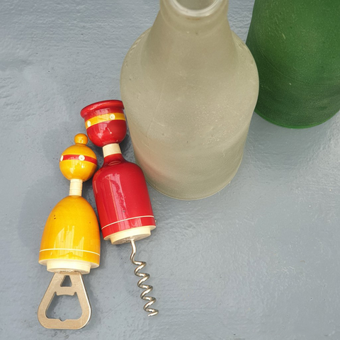 red and yellow wooden cork and bottle openers