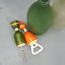 green and orange wooden cork and bottle openers
