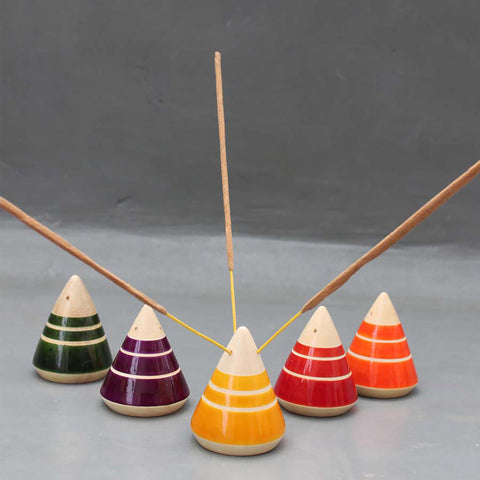 red, yellow, green, purple and orange wooden incense holders