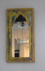 Rustic yellow and blue distressed mirror on wall