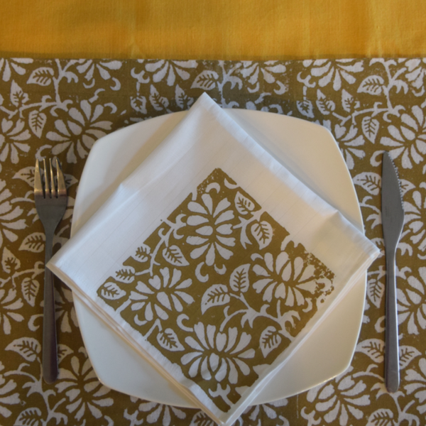 Mustard table runner with brown and white table mat and napkin