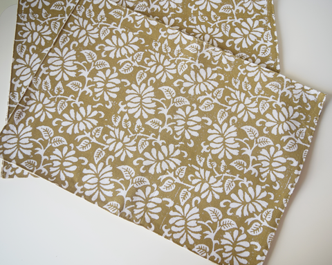 brown table mats with white floral block print
