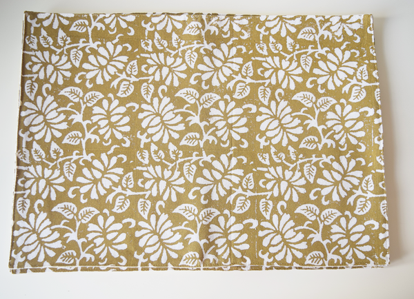 brown table mat with white floral block print