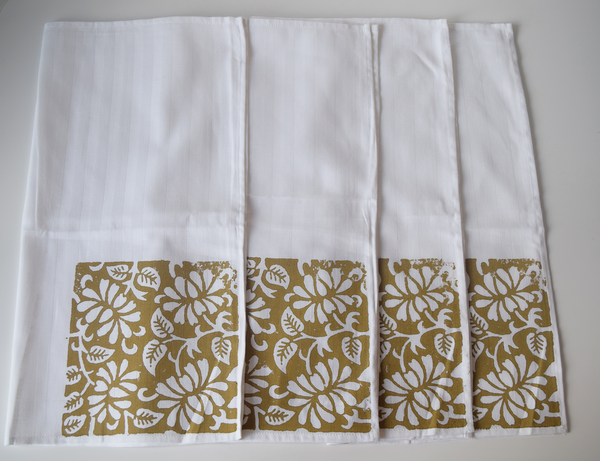white napkins with brown block print on end