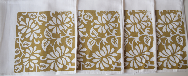 brown block print detailing on white napkins