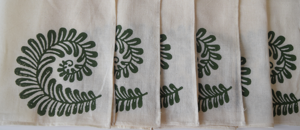 cream napkins with green fern block print.