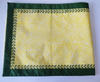 yellow table runner with green edging