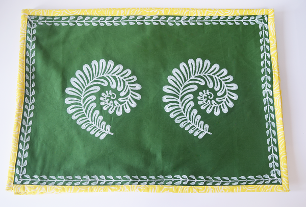 green table mat with white fern block print and yellow edging