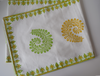 green and yellow fern pattern on white runner with green and yellow border