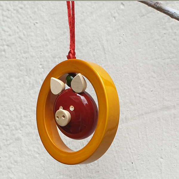 Yellow and red Oink-in-a-ring Christmas ornament