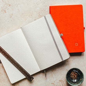 open minimalist square grid notebook