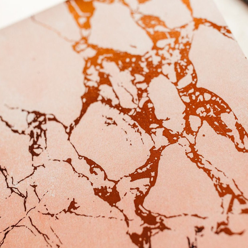 Close up Pink thin marble notebook