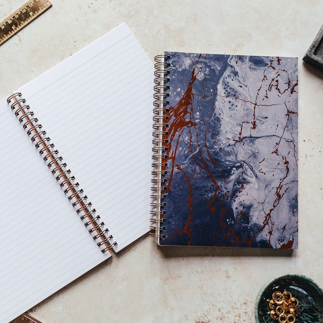Blue marble notebook open