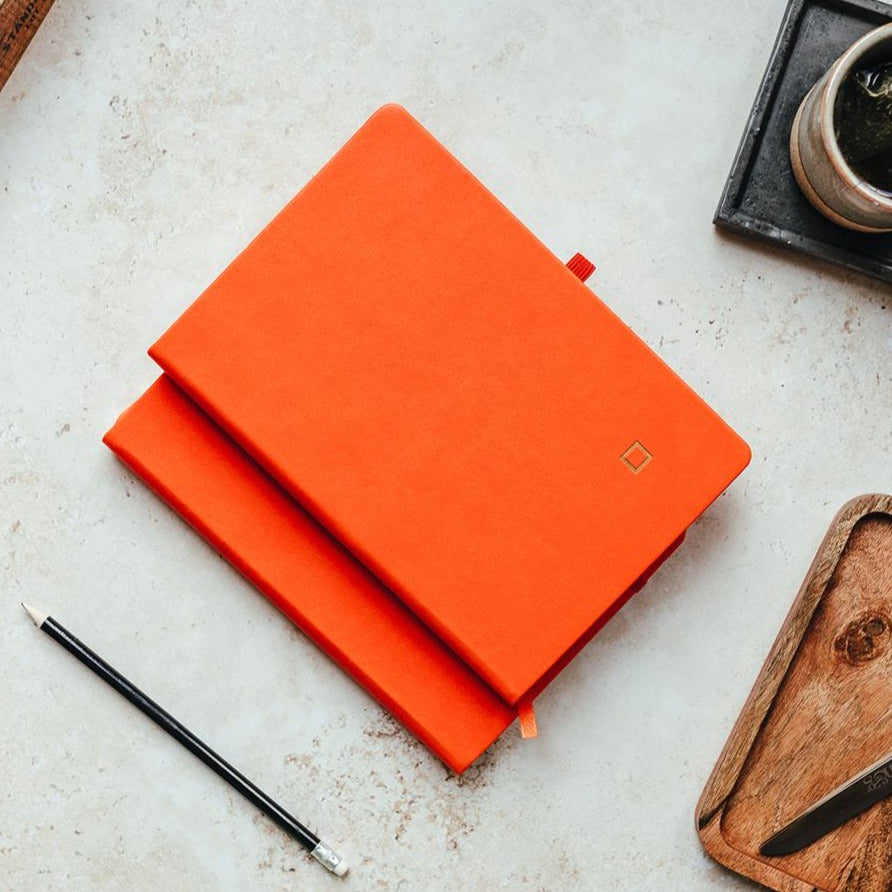 minimalist orange stacked notebook