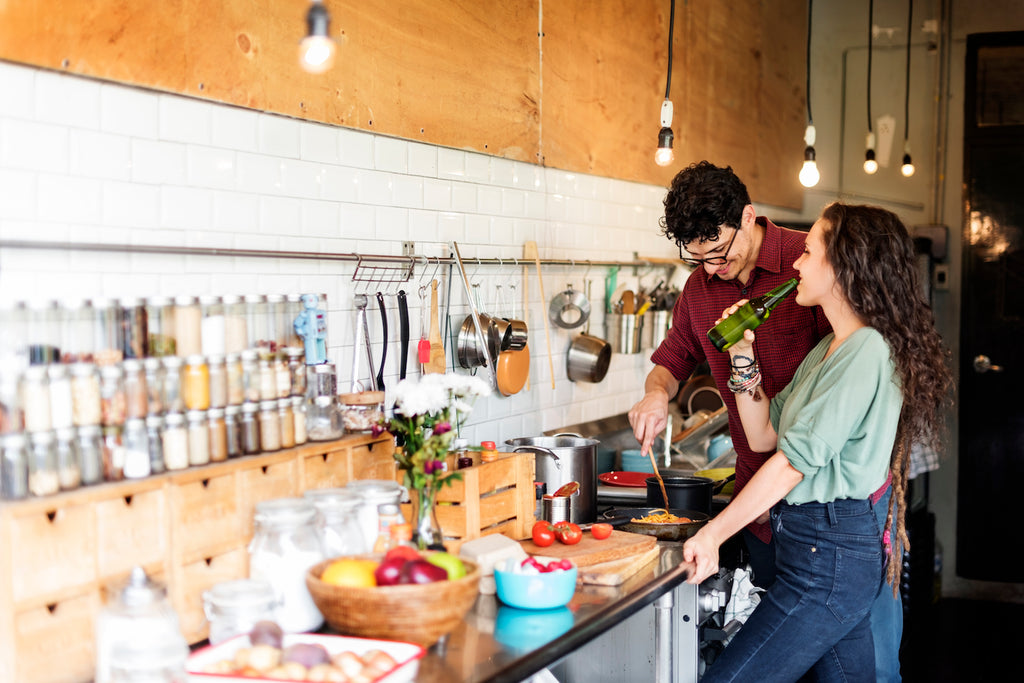 Couple celebrating Valentines day and cooking together at home
