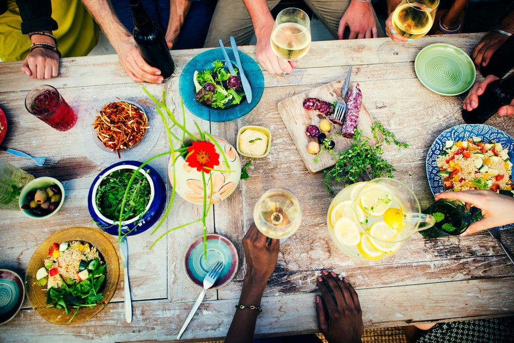 Cookery chefs serve a dinner party