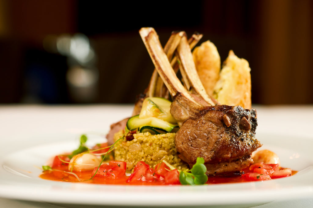 Cookery chefs serve grilled lamb chops