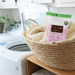 Forever New 3kg Powder Pouch Fabric Wash Soft Scented, front lifestyle view of the package in a laundry basket.
