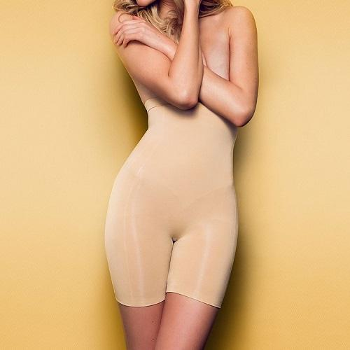 Front view of the Body Hush Sculptor All in One shapewear high waisted short in nude on a model.