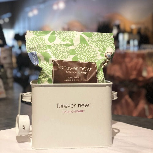 Laundry Room Tin with 3kg Forever New Fabric Wash Powder on display in store, front view.