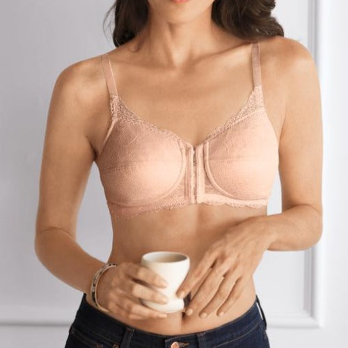 Ellen Post Surgical Front-Closure Bra in Rose/Nude, worn by model in front view lifestyle image styled with jeans and holding a cup of coffee.
