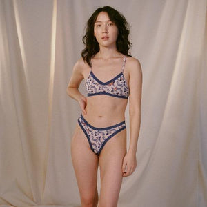 Micro Lace Trim Thong in Koi, worn by model with matching bra in front view lifestyle image.