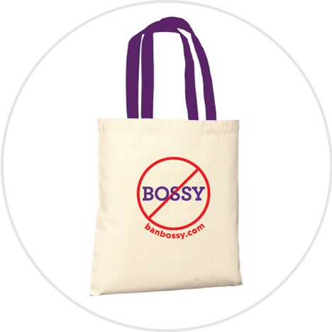 White tote bag with purple handles and ban bossy logo