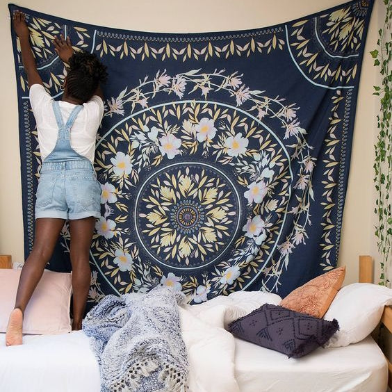 How to hang up a tapestry in dorm room without using nails or anything that will leave holes?