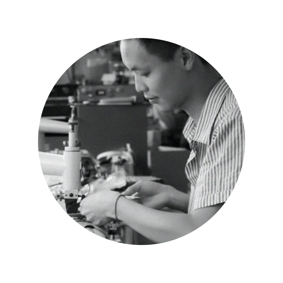 Photo of factory worker at Sans Beast handbag manufacturing location stitching a panel of fabric.