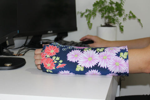 girl wearing decorative arm cast cover at work