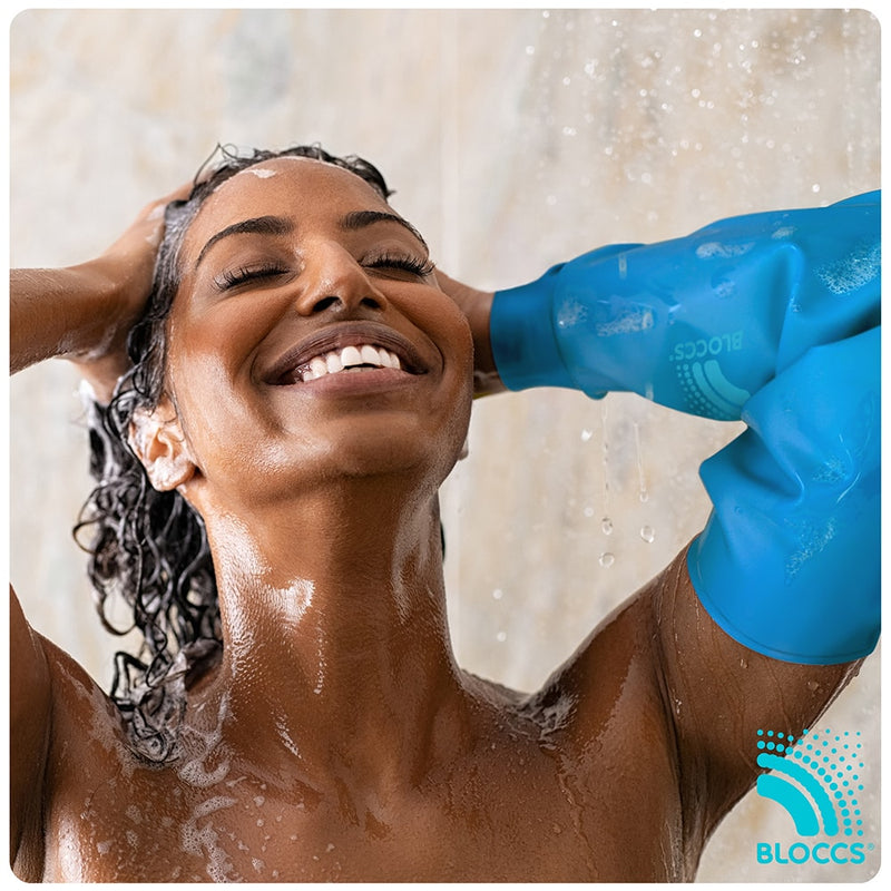 woman showering with a bloccs waterproof elbow cover