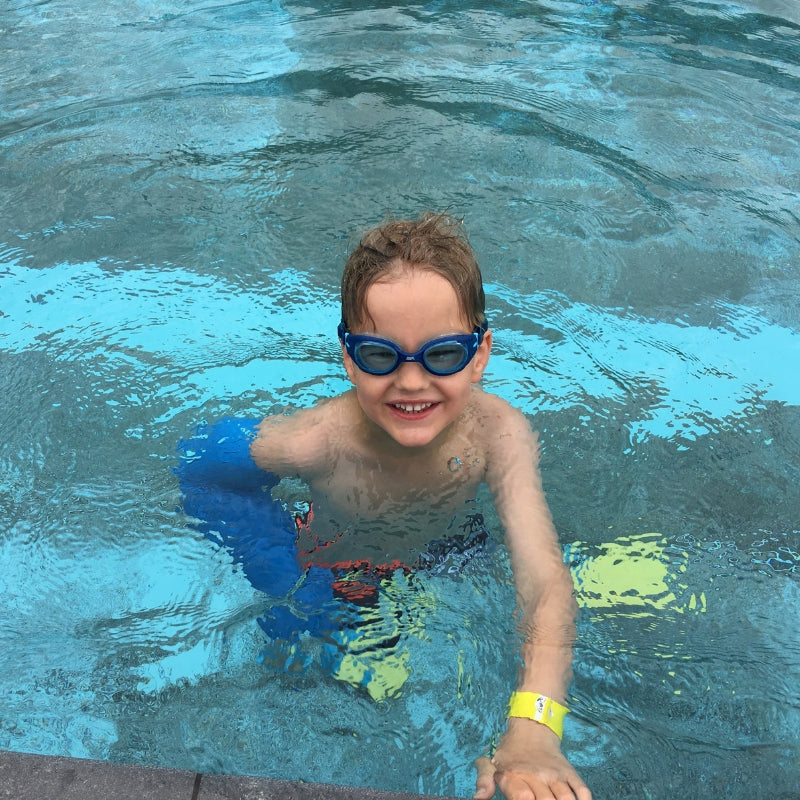 Beth's son swimming with his waterproof full arm cover