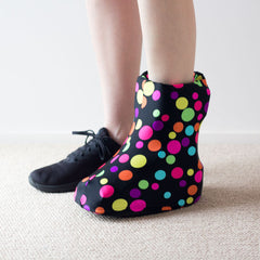 girl wearing a decorative moon boot cover
