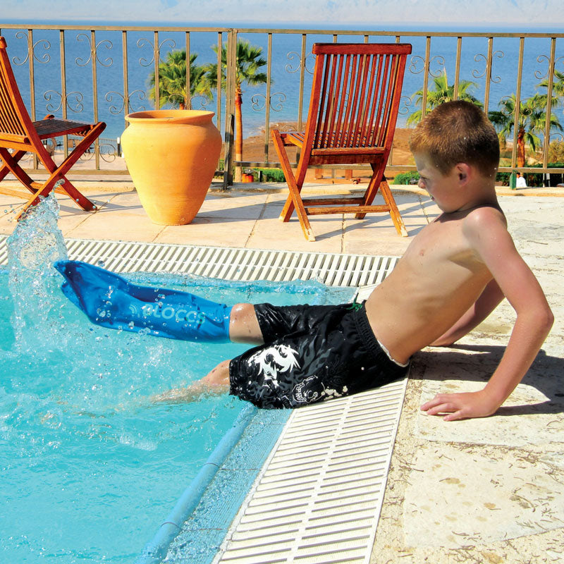 Boy wearing waterproof short leg cover at swimming pool